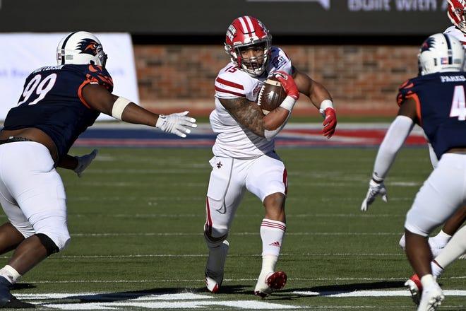 Louisiana-Lafayette running back Elijah Mitchell runs between UTSA defensive lineman Brandon Matterson and safety Antonio Parks during the Ragin' Cajuns 31-24 win in the First Responder Bowl in Dallas Saturday.