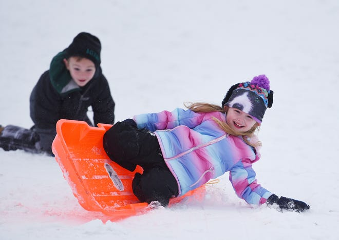 Knox Arcioppo, 6, watches as his sister, Juliet Arcioppo, 5, bails out of her sled Saturday afternoon at Old Economy Park in Harmony Township.