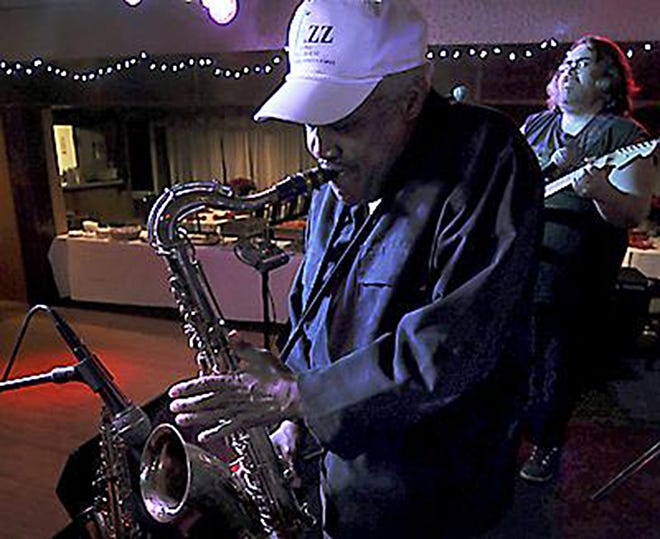 Aliquippa's Sonny Childs plays his saxophone at The Venue at Harmony Ridge in Harmony Township in this 2011 file photo. In the back is Bobby Eaton of Harmony Township.