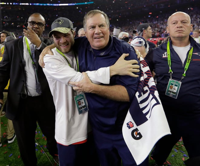 New England Patriots head coach Bill Belichick celebrates with his son Brian after the Super Bowl victory over the Atlanta Falcons in 2017.