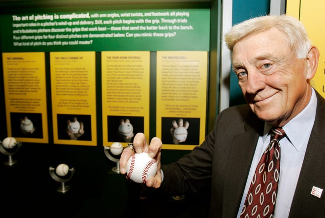 Phil Niekro holds a knuckleball at the Great Lakes Science Center in Cleveland.