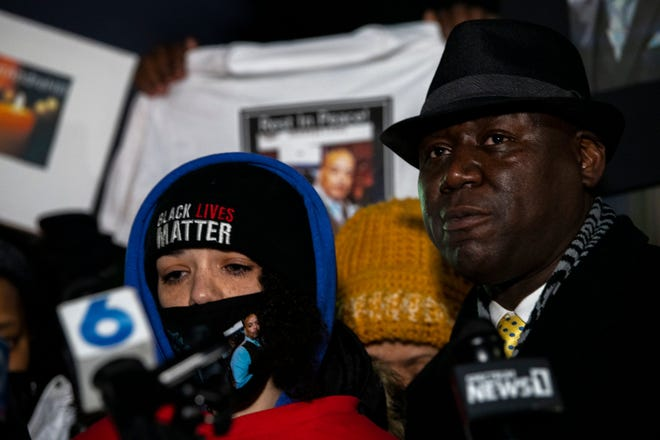 Karissa Hill, daughter of Andre' Hill, stands beside Attorney Ben Crump during a vigil for her father at Brentnell Community Recreation Center on Dec. 26.