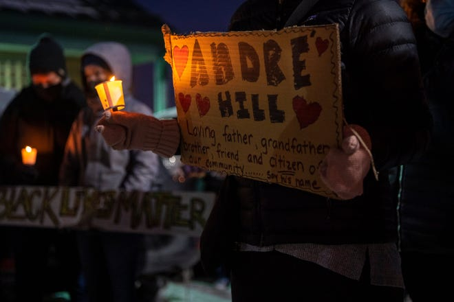 A vigil is held for Andre Hill at Brentnell Community Recreation Center in late December.
