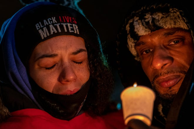 Karissa Hill, daughter of Andre' Hill, reacts during a vigil being held for her father at Brentnell Community Recreation Center Saturday.