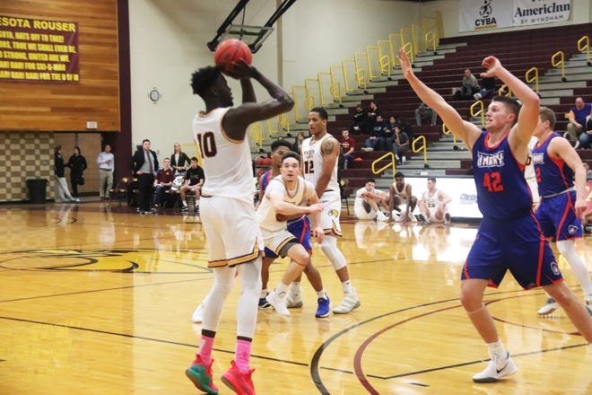 Ibu Jassey Demba takes a shot in a game against the University of Mary on Jan. 25, 2020. Jassey Demba is the lone senior on the Minnesota Crookston men's basketball team.