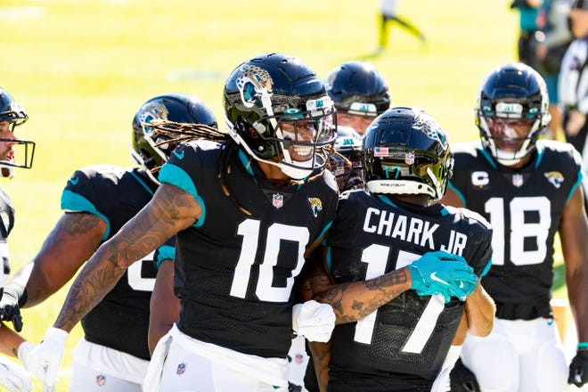 Jaguars receivers Laviska Shenault (10) and DJ Chark (17) celebrate a touchdown against the Bears in December. Both are among the pass-catching options for Trevor Lawrence entering the 2021 preseason.