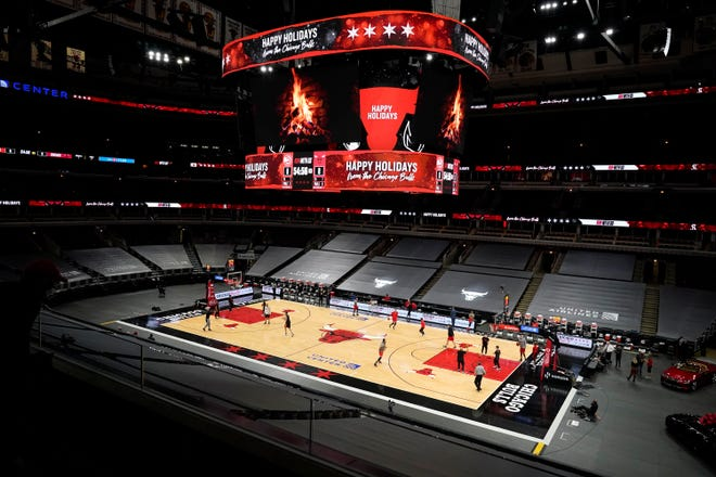 Players from the Atlanta Hawks and the Chicago Bulls players warm up for an NBA basketball game in Chicago, Wednesday, Dec. 23, 2020. (AP Photo/Nam Y. Huh)