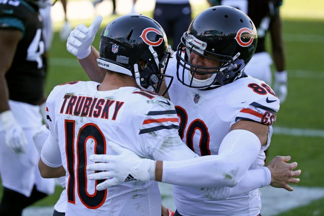 Chicago Bears quarterback Mitchell Trubisky (10) celebrates his touchdown run against the Jacksonville Jaguars with teammate tight end Jimmy Graham during the second half of an NFL football game, Sunday, Dec. 27, 2020, in Jacksonville, Fla. (AP Photo/Stephen B. Morton)