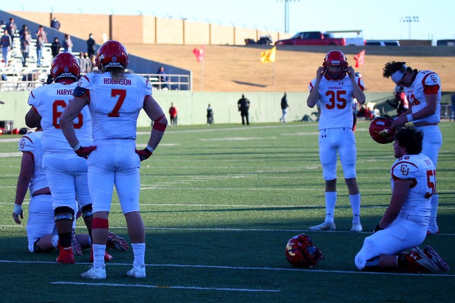 Coronado's  special teams look in Shock as their extra point is blocked during the second overtime of the Regional finals of the playoffs as they loss to Red Oak 42-41