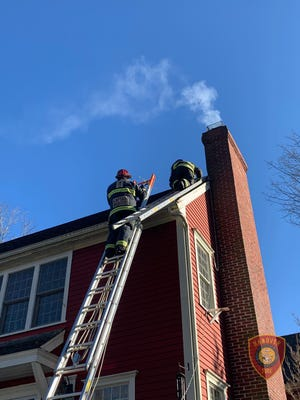 Firefighters work to put out a chimney fire at a Hanover house.