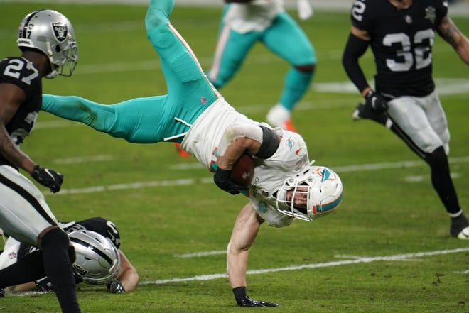 Miami Dolphins safety Clayton Fejedelem #42 is tackled after a fake punt run during the second quarter against the Las Vegas Raiders in an NFL football game, Saturday, Dec. 26, 2020, in Las Vegas. (AP Photo/Jeff Bottari)