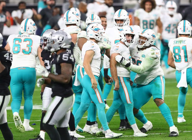 The Dolphins celebrate Jason Sanders' winning field goal with one second left against the Raiders. They had more to celebrate on their day off Sunday.