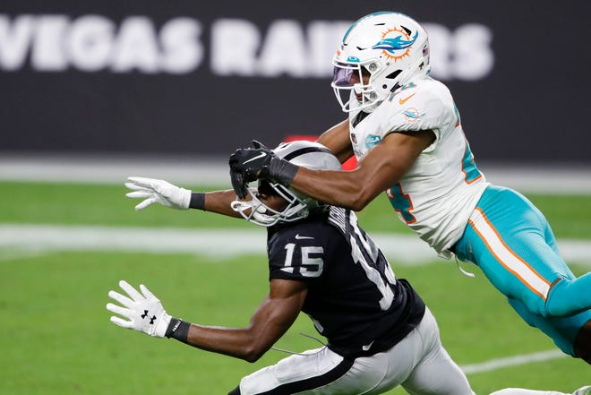 Dolphins cornerback Byron Jones is called for pass interference against Raiders receiver Nelson Agholor, resulting in a 49-yard penalty that set up a field goal.
