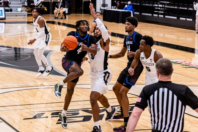 DePaul's Javon Freeman-Liberty drives the lane and is defended by Providence's Nate Watson in the first half Sunday at Alumni Hall.