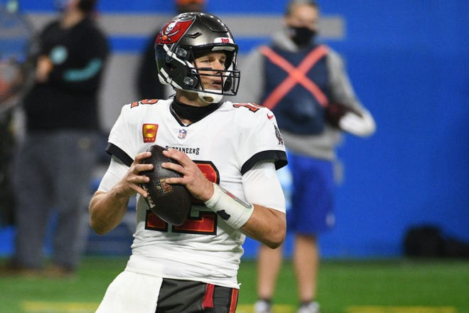 Buccaneers quarterback Tom Brady drops back to pass against the Detroit Lions Saturday at Ford Field.