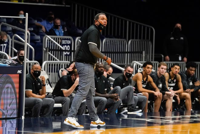 Providence head coach Ed Cooley shouts during the second half of an NCAA college basketball game against Butler, Wednesday, Dec. 23, 2020, in Indianapolis. AP Photo/Darron Cummings) ORG XMIT: INDC113