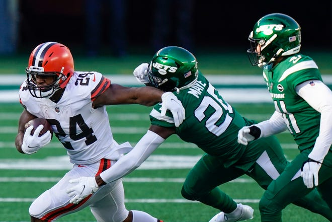 New York Jets defensive back Marcus Maye (20) tackles Cleveland Browns running back Nick Chubb (24) during the first half Sunday, Dec. 27, 2020, in East Rutherford, N.J. [Corey Sipkin/Associated Press]
