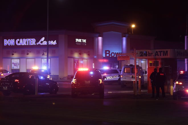 Police investigate a shooting Saturday at Don Carter Lanes in Rockford. Three people were killed, and three others were injured. One person was taken into custody.