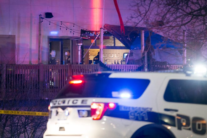 Rockford police work in the second-floor bar area to investigate the scene of a shooting at Don Carter Lanes on Saturday, Dec. 26, 2020, in Rockford, that left three people dead and three others wounded. One person of interest was in custody, according to Rockford Police Chief Dan O'Shea.