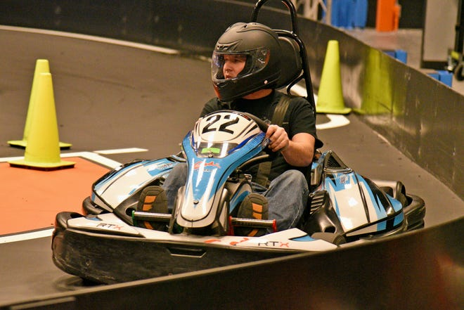 """Danny Morrison Jr., of Minneapolis, pulls into the pit after getting his """"speedway"""" fix while on the new indoor go-kart track at The District Eats and Play located at Salina Central Mall on Saturday.  Morrison who is a racecar driver said """"they are a blast!"""""""
