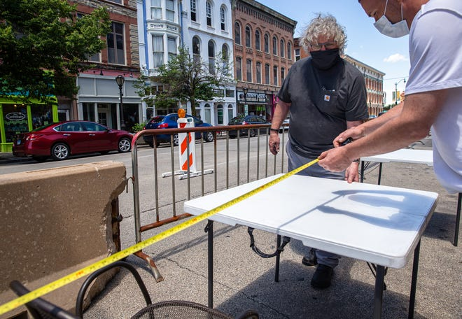 Maldaner's Chef-Owner Michael Higgins measures out the required distance between tables to follow the social distancing guidelines for outdoor dinning in front of the restaurant on South Sixth Street during the COVID-19 pandemic. LLCC Culinary Institute is pairing up Maldaner's for one its themed dinners.
