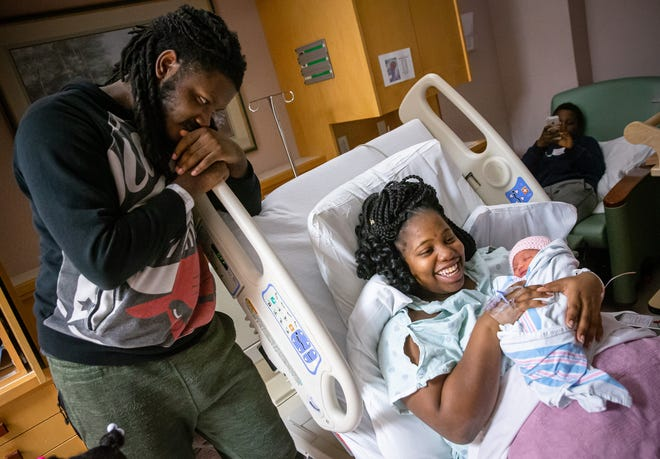 Erica Montgomery, center, and Ashton Hamilton, left, were the lucky parents of the first baby born in Springfield for 2020 as their daughter A'Nylah Hamilton was born at 1:40 a.m. on New Year's Day at HSHS St. John's Children's Hospital, Wednesday, Jan. 1, 2020, in Springfield, Ill. [Justin L. Fowler/The State Journal-Register]