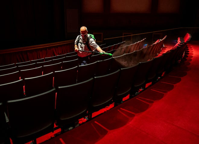 Terry Rutherford, with the ALPLM Building and Grounds crew, uses a sprayer to apply disinfectant to the seats of the Union Theater at the Abraham Lincoln Presidential Museum as the ALPLM prepares to reopen to the public during the COVID-19 pandemic June 30 in Springfield. On Jan. 18, the Illinois Department of Public Health announced museums could open at 25% capacity as Region 3 enters Phase 4 guidelines — the least-strict level in the Restore Illinois Plan before the economy is allowed to reopen completely.
