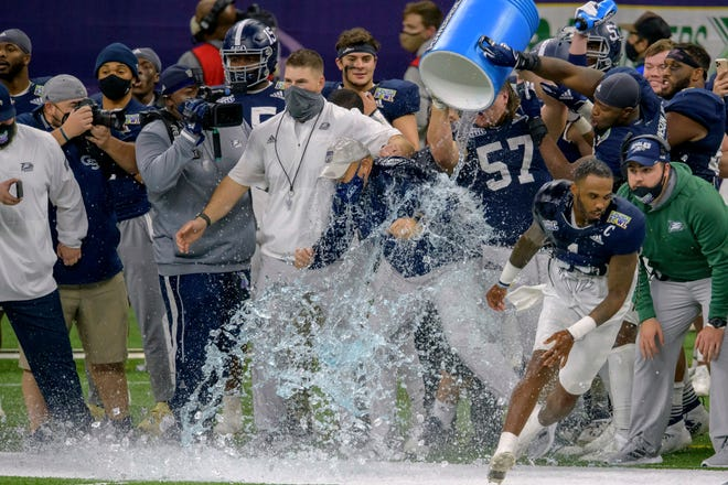 Georgia Southern head coach Chad Lunsford gets doused as his team starts to celebrate a 38-3 victory over Louisiana Tech in the New Orleans Bowl game on Wednesday.