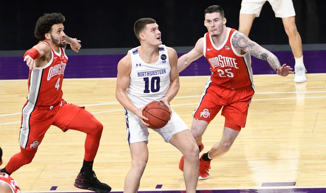 Northwestern forward Miller Kopp (10) drives to the basket as Ohio State forward Kyle Young (25) guards him on Saturday, Dec. 26, 2020, in Evanston, Ill.