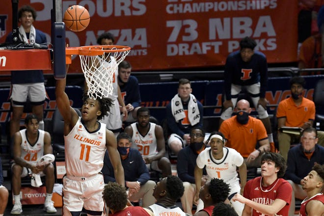 Illinois guard Ayo Dosunmu (11) lays the ball in against Indiana Saturday, Dec. 26, 2020, in Champaign.