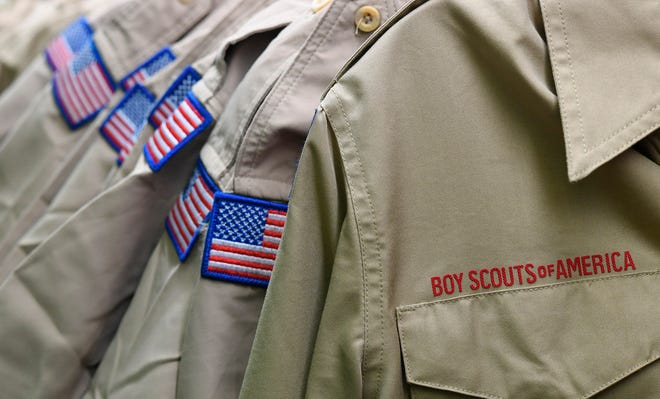 In this Feb. 18, 2020, file photo, Boy Scouts of America uniforms are displayed in the retail store at the headquarters for the French Creek Council of the Boy Scouts of America in Summit Township, Pa.