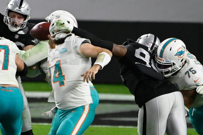 Despite this facemask penalty, Miami quarterback Ryan Fitzpatrick still managed to complete this pass.