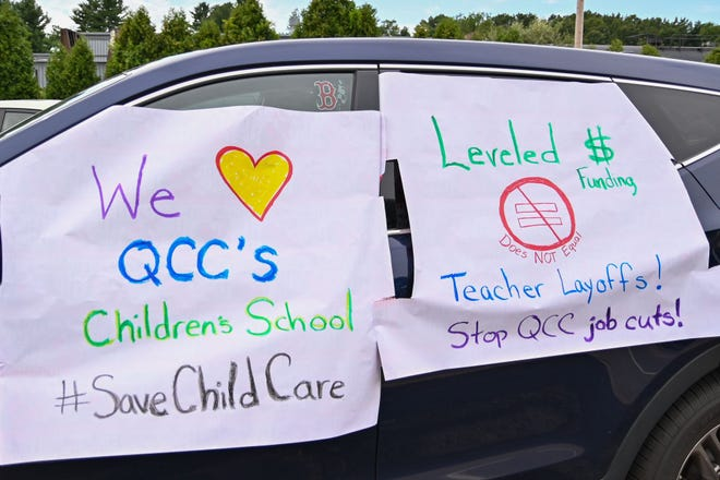A car in a Quinsigamond Community College parking lot displays signs of support for the closed Children's School on campus, while protesting the cuts, furloughs and layoffs there. QCC officials say the school will remain closed through the winter and spring.