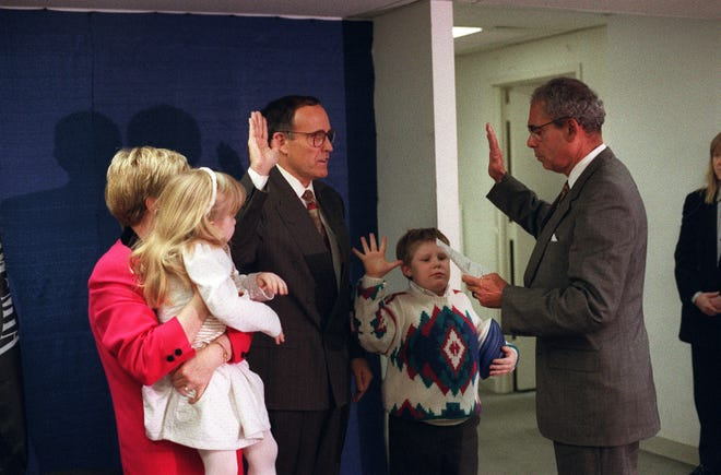 Rudolph Giuliani is sworn in as the 107th mayor of New York City by City Clerk Carlos Cuevas, right, at campaign headquarters on Dec. 28, 1993. With Giuliani, from left, are his wife, Donna Hanover Giuliani, daughter Caroline, son Andrew.