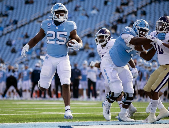 Javonte Williams gallops into the end zone to finish a touchdown run during North Carolina's blowout of Western Carolina earlier this month.