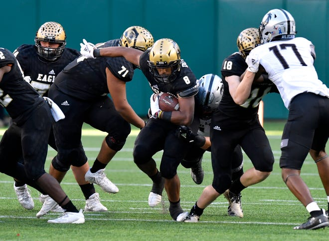 Abilene High running back Phonzo Dotson carries the ball during Saturday's playoff football game against Denton Guyer at Globe Life Park in Arlington. Final score was 38-21, Denton Guye
