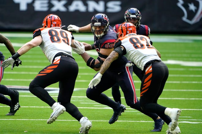 Houston defensive end J.J. Watt, here competing against the Bengals last December 27, announced Friday that he and the Texans have decided to part ways.