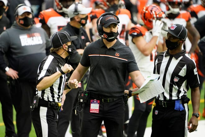 Cincinnati Bengals Zac Taylor talks with officials during the second half of an NFL football game against the Houston Texans Sunday, Dec. 27, 2020, in Houston.