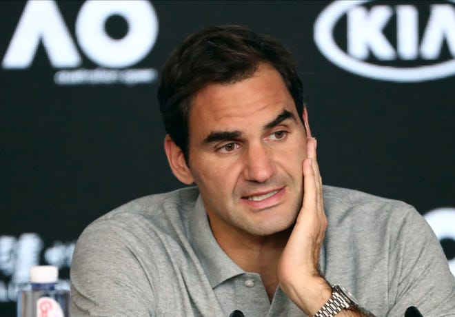 In this Jan. 30 photo, Switzerland's Roger Federer speaks during a press conference following his semifinal loss to Serbia's Novak Djokovic at the Australian Open tennis championship in Melbourne, Australia.