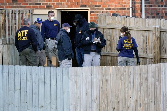 FBI and ATF agents search the basement of a home Saturday, Dec. 26, 2020, in Nashville, Tenn.