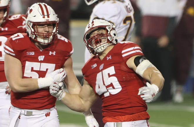 Inside linebacker Leo Chenal, right, was second in tackles last season with 46 and led the Badgers in sacks (three), quarterback hurries (seven) and tied for the team lead in tackles for loss (six).
