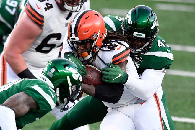 Browns running back Kareem Hunt (27) rushes for a touchdown against the New York Jets in the second half Sunday, Dec. 27, 2020, at MetLife Stadium in East Rutherford. The Jets defeat the Browns 23-16. [Danielle Parhizkaran/NorthJersey.com]
