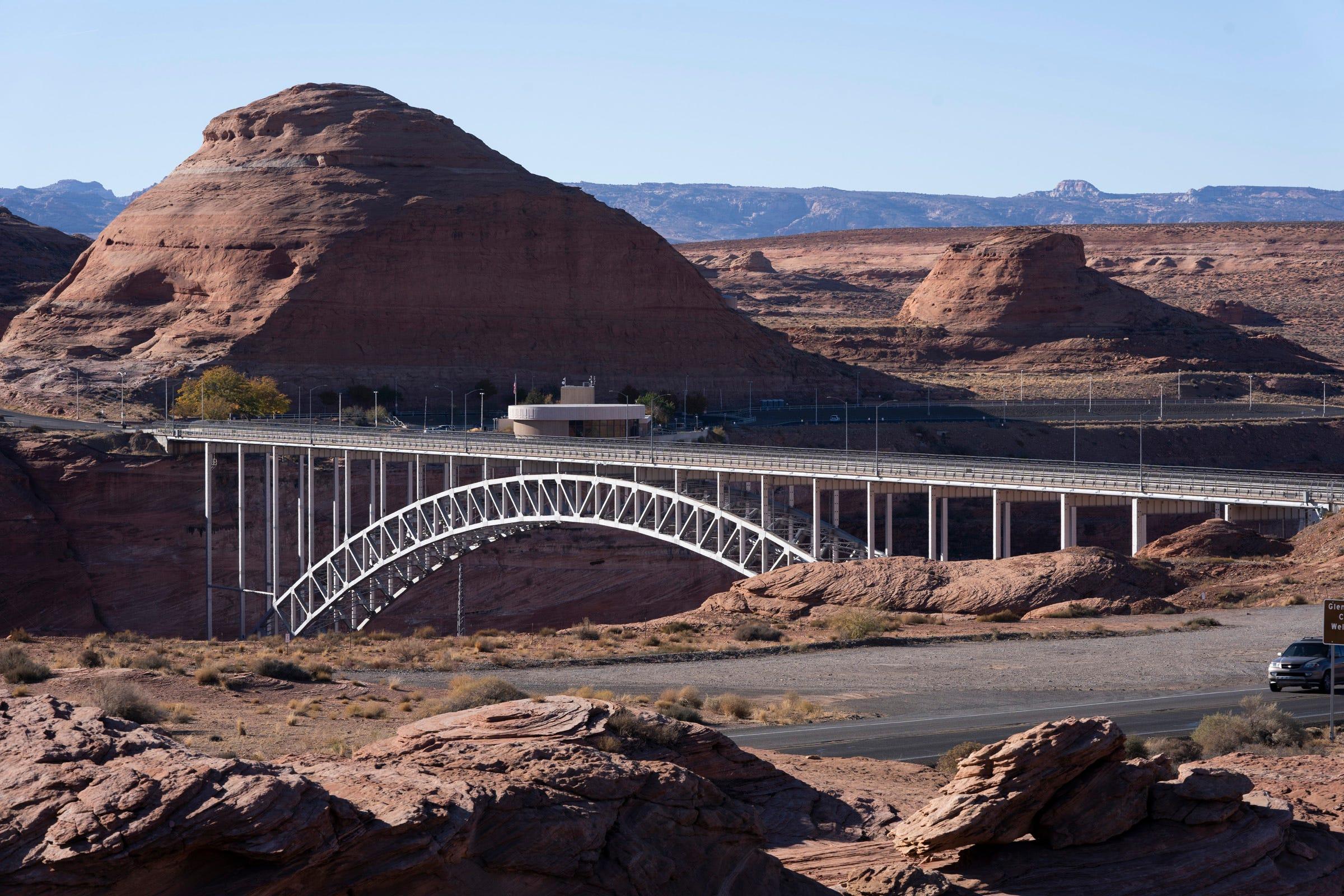 Glen Canyon Bridge crosses the Colorado River next to Glen Canyon Dam and Lake Powell.