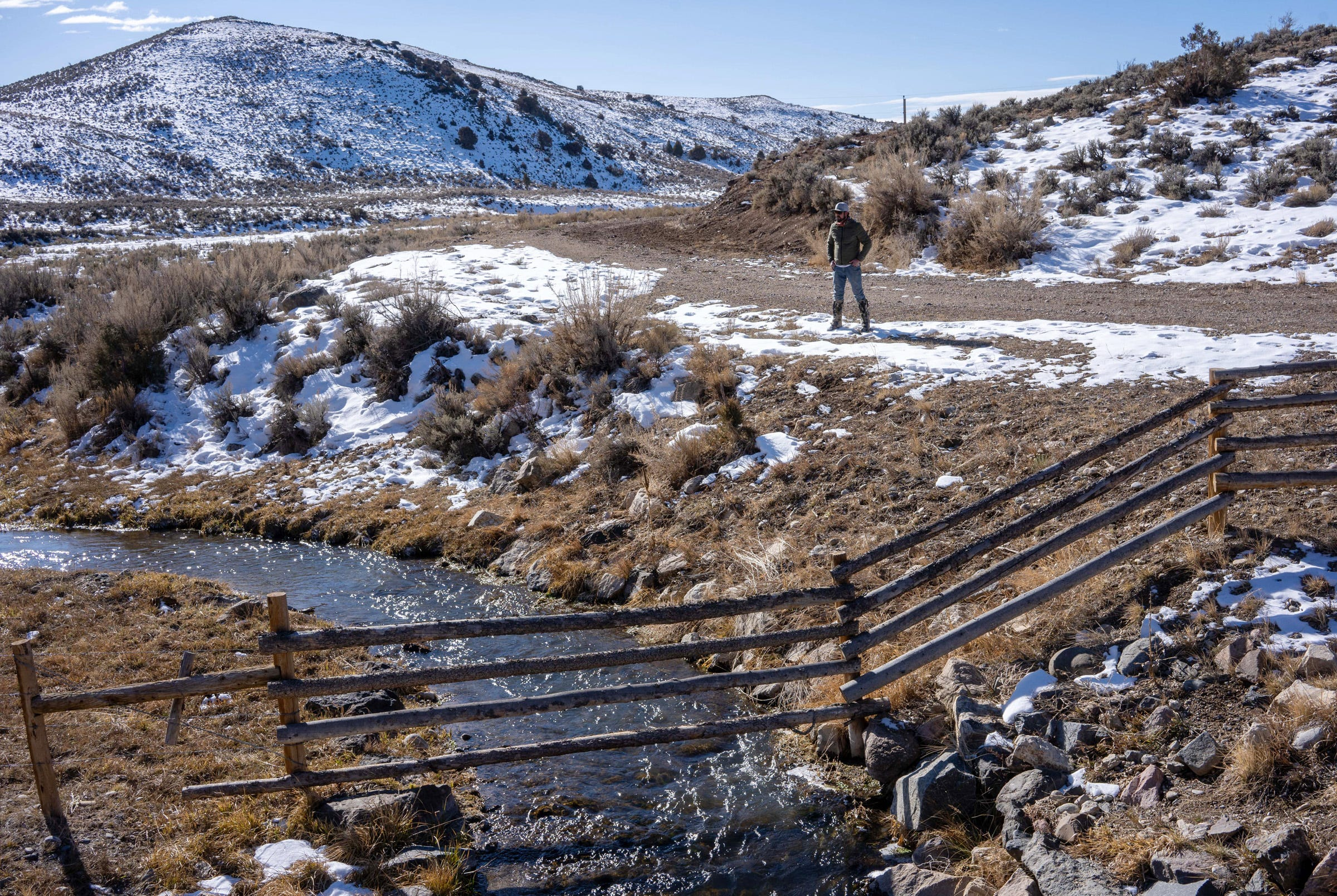 Rancher Paul Bruchez stands beside Reeder Creek, which flows into the Colorado River near Kremmling, Colorado.