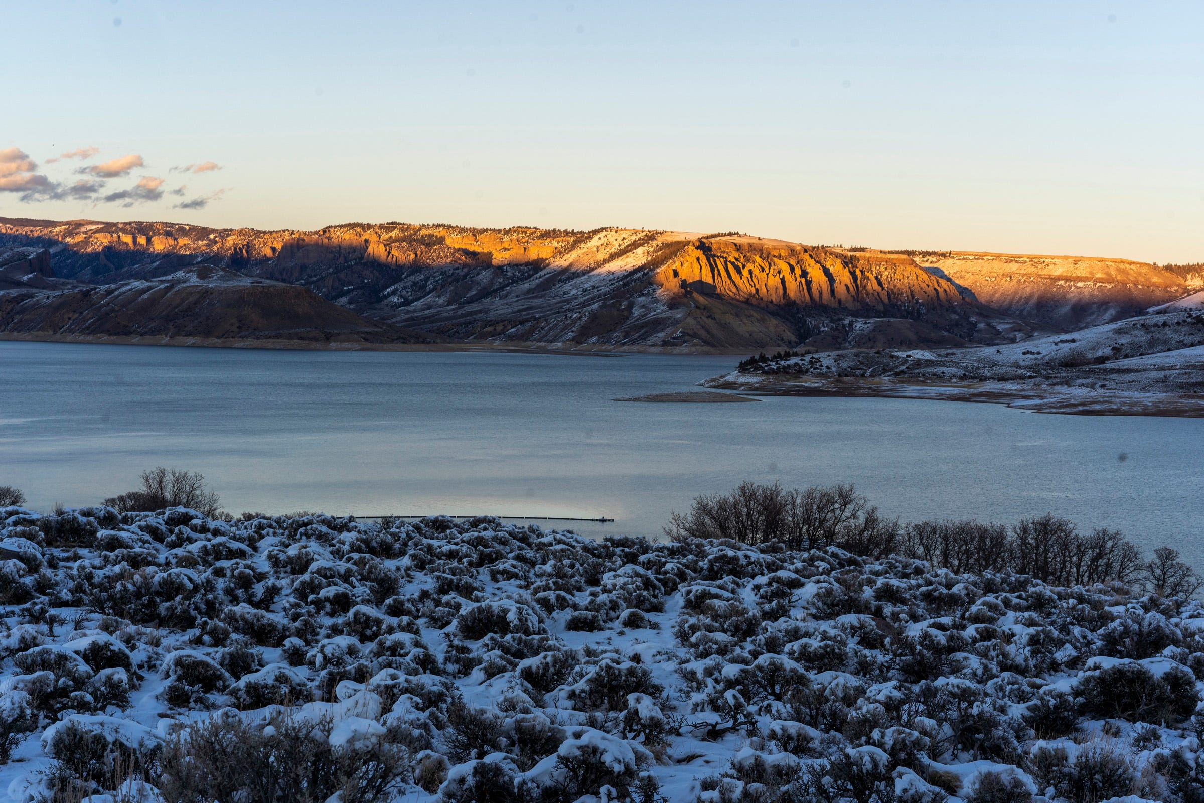 Blue Mesa Reservoir holds water from the Gunnison River, a major tributary of the Colorado River. The levels of the reservoir now stand at 48% of full capacity after a hot, dry year.