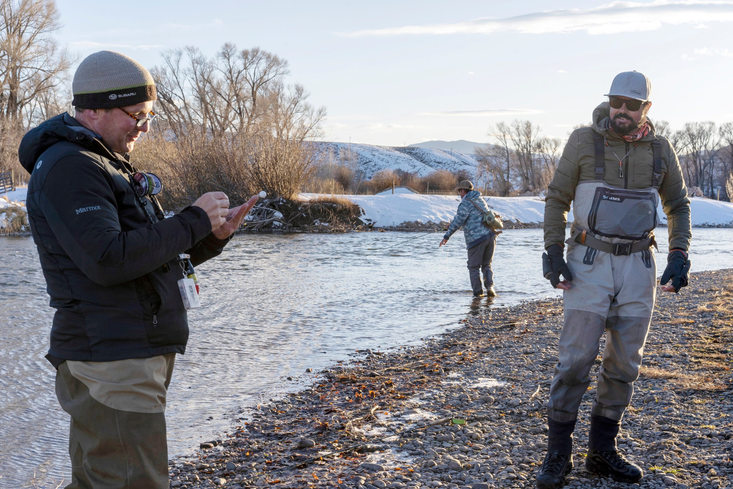 Andy Mueller, left, general manager of the Colorado River District, and Matt Rice, center, director of Colorado River programs for American Rivers, visit with rancher Paul Bruchez, right, as they fish for trout in the Colorado River near Kremmling, Colorado. They met to celebrate after voters passed a ballot measure that will raise taxes and generate nearly $5 million a year for the Colorado River District.