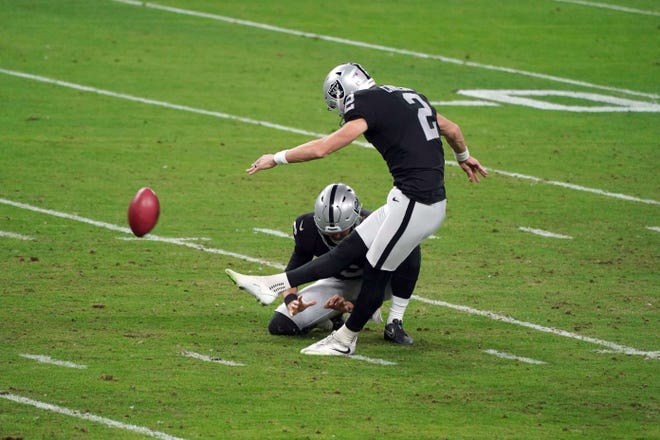 Las Vegas Raiders kicker Daniel Carlson (2) kicks a 38-yard field goal with punter A.J. Cole (6) on the hold against the Miami Dolphins in the second quarter.
