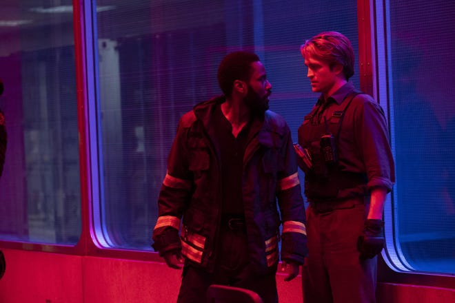 "John David Washington, left, and Robert Pattinson in a scene from ""Tenet."""
