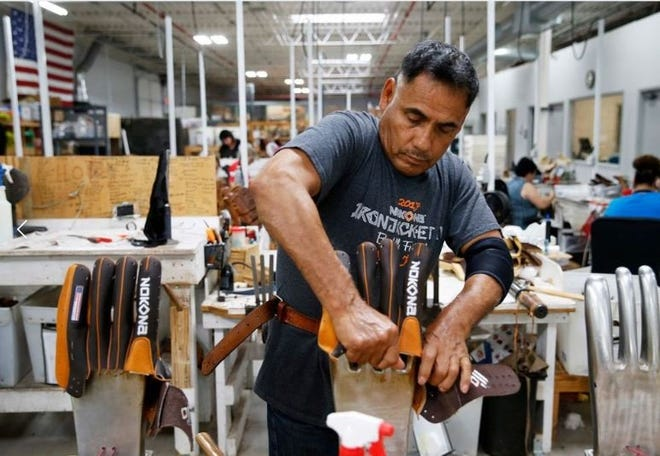 Martin Gomez works on stretching gloves before they are stitched at the Nokona factory in Nocona, Texas, last year. A measure of the Texas manufacturing sector showed improvement in December, according to new data from the Federal Reserve Bank of Dallas.