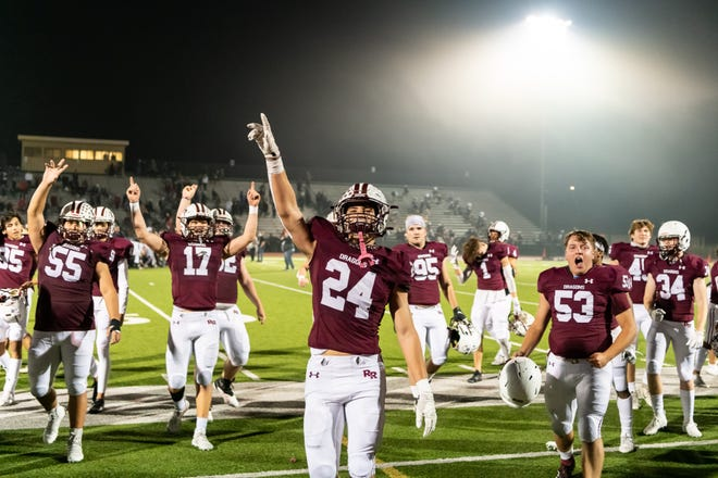 Carson Otworth celebrates with Round Rock teammates after a win over Lake Travis in the first round of the playoffs. Round Rock hadn't won a home playoff game as a district champion since 1946.